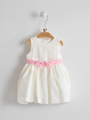 Elegant and refined cream coloured dress with bow for baby girl