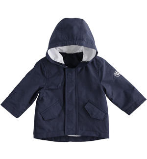 Blue baby boy jacket of opaque nylon parka model