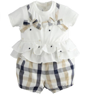 100% cotton romper with white top with polka dot embroidery and double ruffles at the waist