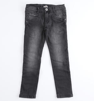 Pantalone denim slim fit con rotture