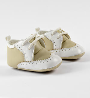 Faux leather baby shoes with fake laces and white details